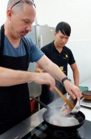 Al searing the pork