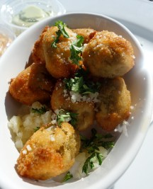 Crumbed and stuffed green olives