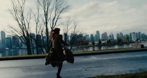 Elianna the sorceress runs across a modern road in Vancouver.