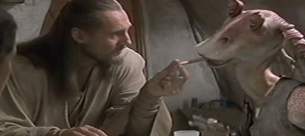 Qui-Gon Jinn, a jedi who shouldn't exist, grabs the tongue of Jar Jar, who also shouldn't exist.