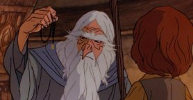 Gandalf holds up the One Ring in the Rankin/Bass cartoon.
