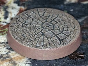 A Citadel base painted using Agrellan Earth.