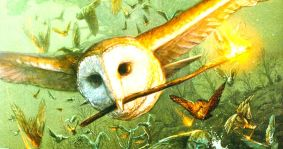 Soren the barn owl flying in a battle with a torch in his beak.