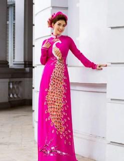 Áo dài nữ hồng cánh sen vẽ chim công