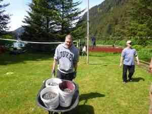 Matt hauls gravel for the drainpipe project.