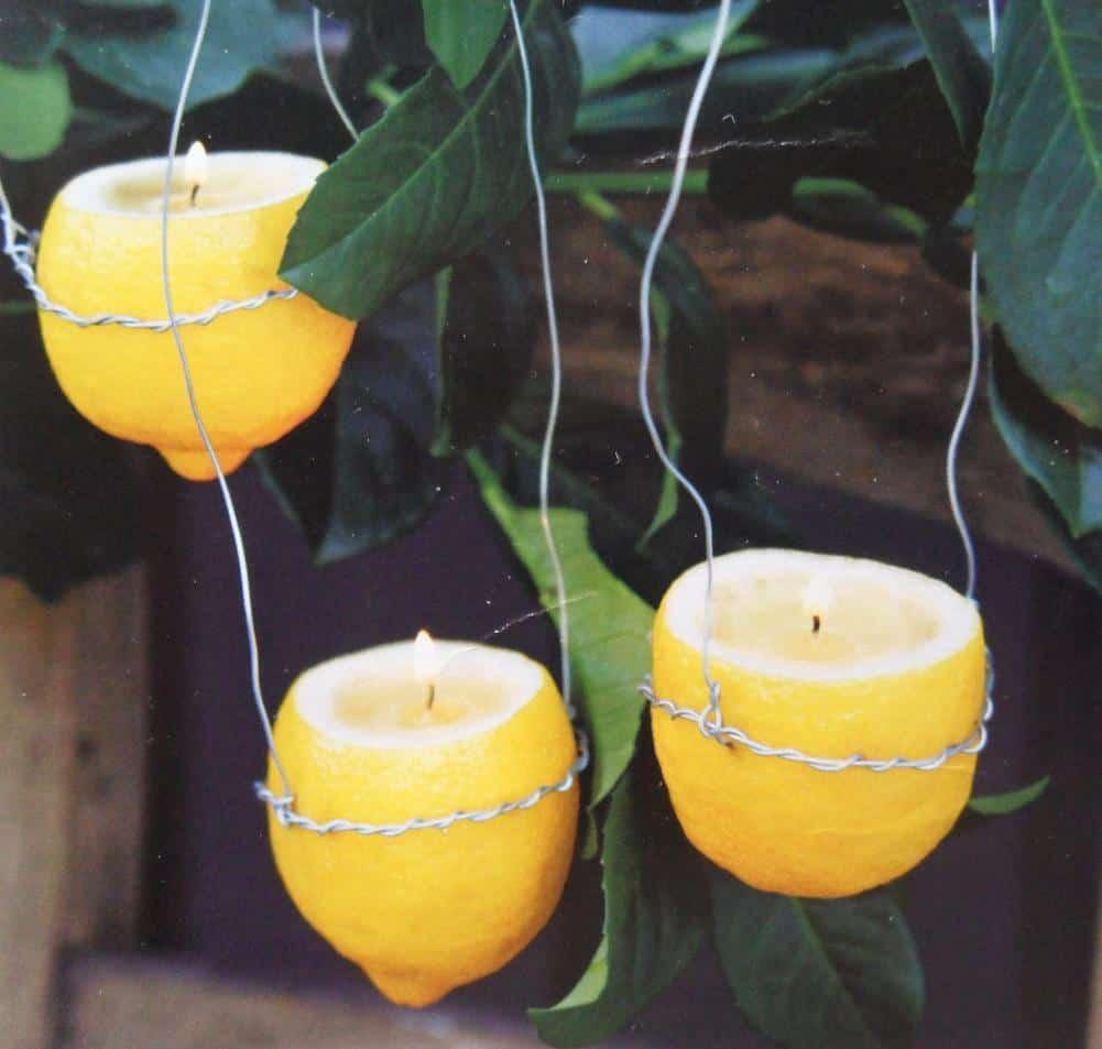 Tuin en terras verlichten met zelfgemaakte citroenkaarsen