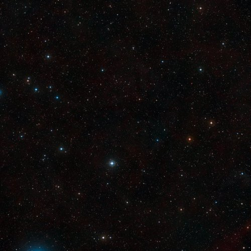 This  visible-light wide-field image of the region around the giant  Lyman-alpha blob LAB1 was created from photographs taken through blue  and red filters and forming part of the Digitized Sky Survey 2. The blob  itself lies at the centre of the image but, despite being huge and very  luminous, it is so distant that it is too faint to be seen clearly on  this picture. The field of view is approximately 2.9 degrees across.