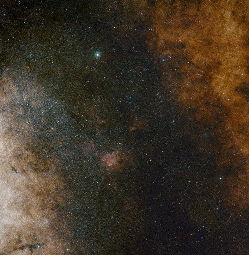 This visible light wide-field view shows the rich star clouds in the constellation of Sagittarius (the Archer) in the direction of the centre of our Milky Way galaxy. The entire image is filled with vast numbers of stars — but far more remain hidden behind clouds of dust and are only revealed in infrared images. This view was created from photographs in red and blue light and forming part of the Digitized Sky Survey 2. The field of view is approximately 3.5 degrees x 3.6 degrees.