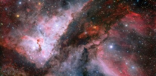 This spectacular panoramic view combines a new image of the field around the Wolf–Rayet star WR 22 in the Carina Nebula (right) with an earlier picture of the region around the unique star Eta Carinae in the heart of the nebula (left). The picture was created from images taken with the Wide Field Imager on the MPG/ESO 2.2-metre telescope at ESO's La Silla Observatory in Chile. This image is available as a mounted image in the ESOshop. #L