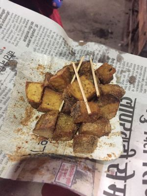 Image of fried garadu yam chaat on a newspaper street food to eat in india