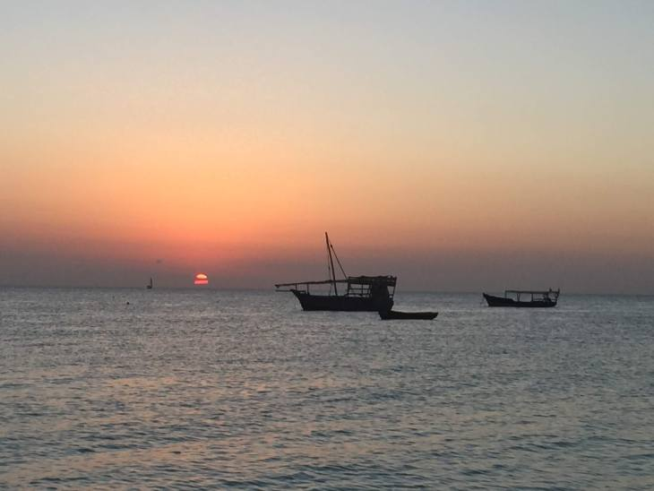zanzibar sunset and a dhow