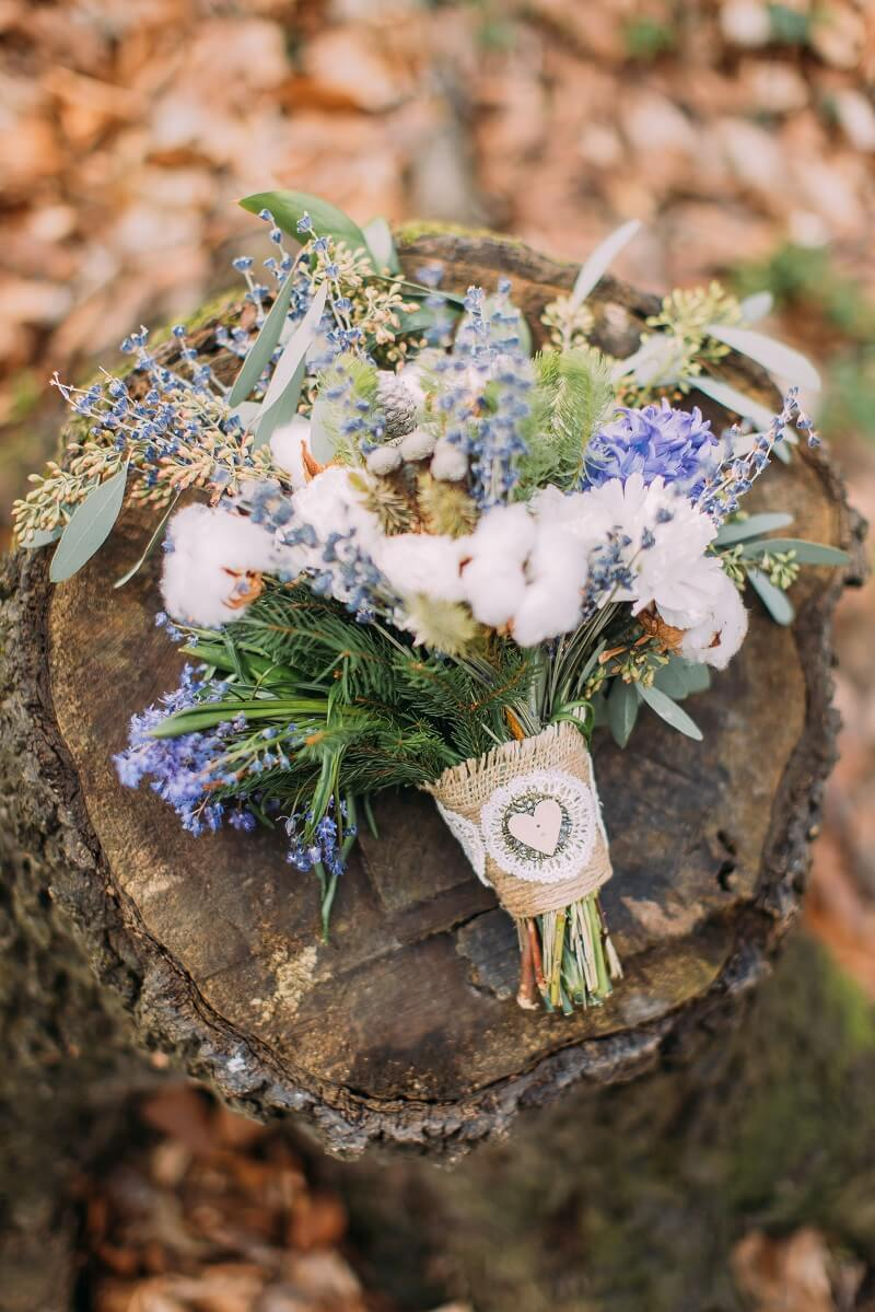 Beautiful wedding bouquet of colorful spring flowers on