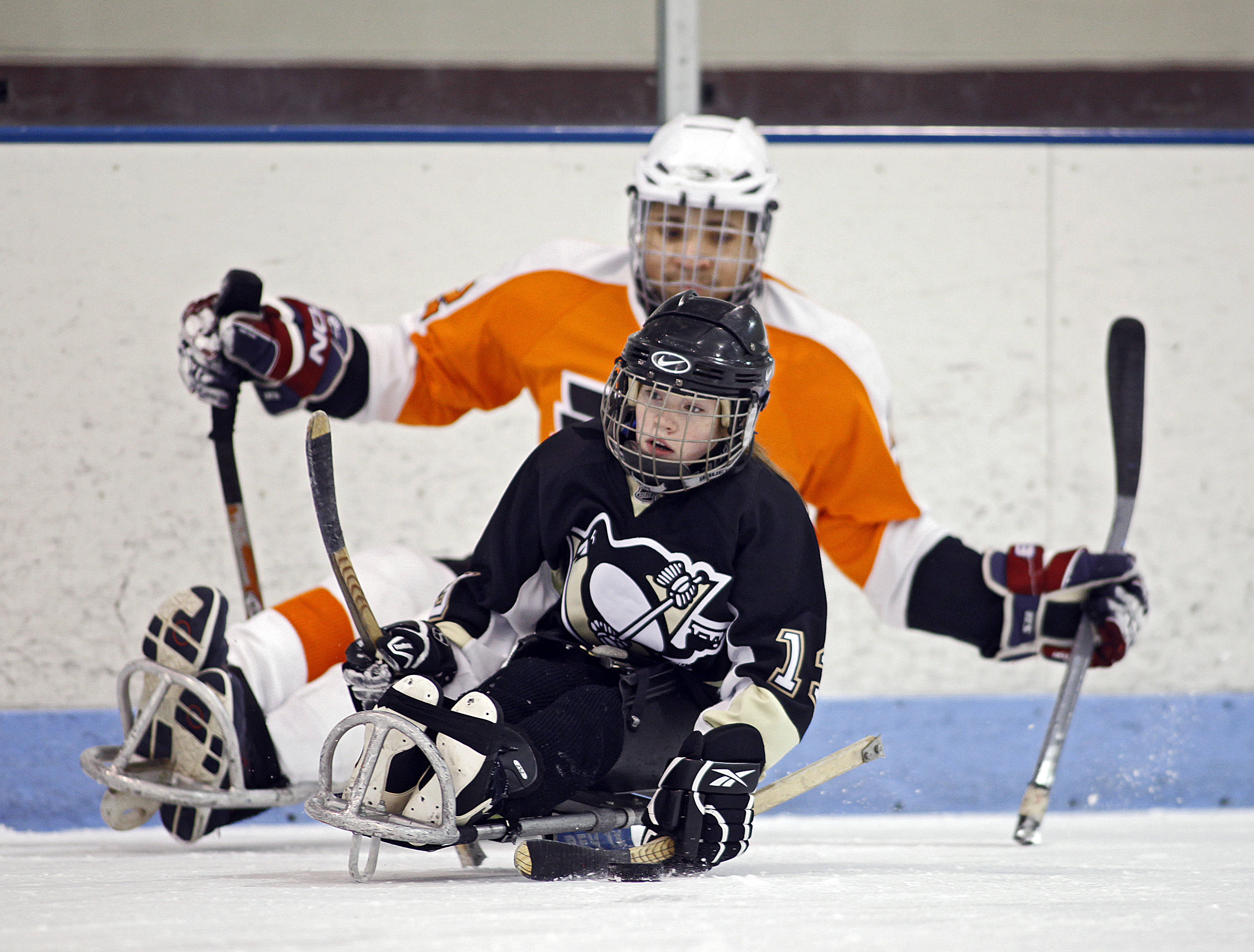Sledge Hockey  Children learning the game at practice