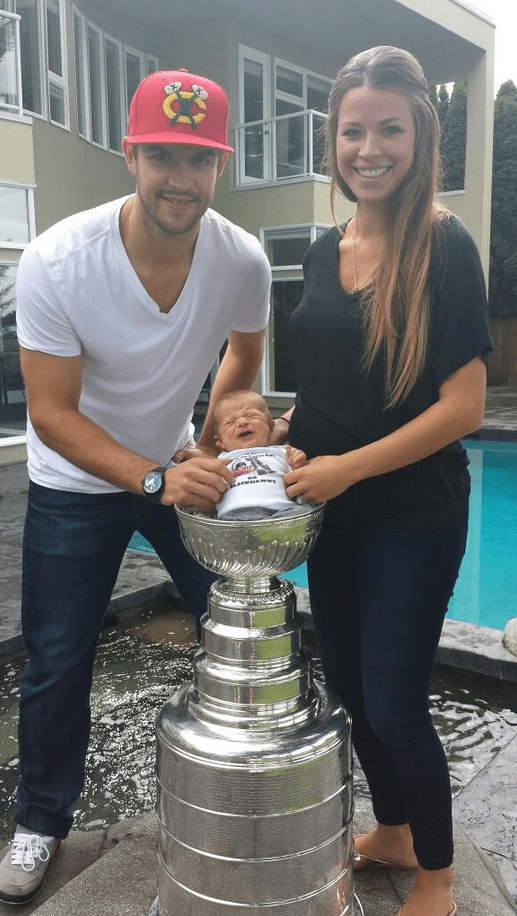 Brent  Dayna Seabrook with baby Carter inside Stanley Cup