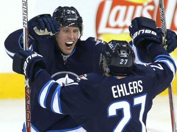 Celebrating 1st NHL hat trick with lineman Ehlers