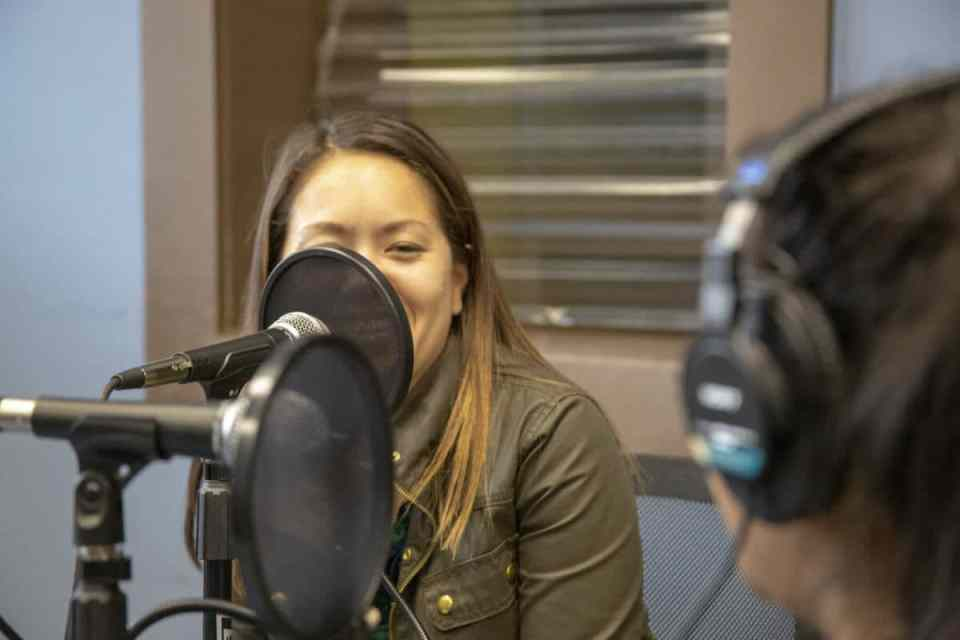 woman talking into podcast microphone