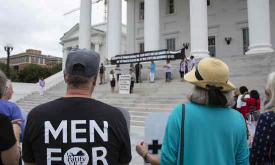 People facing the Capitol building with Pamela Northam and Anne Holton