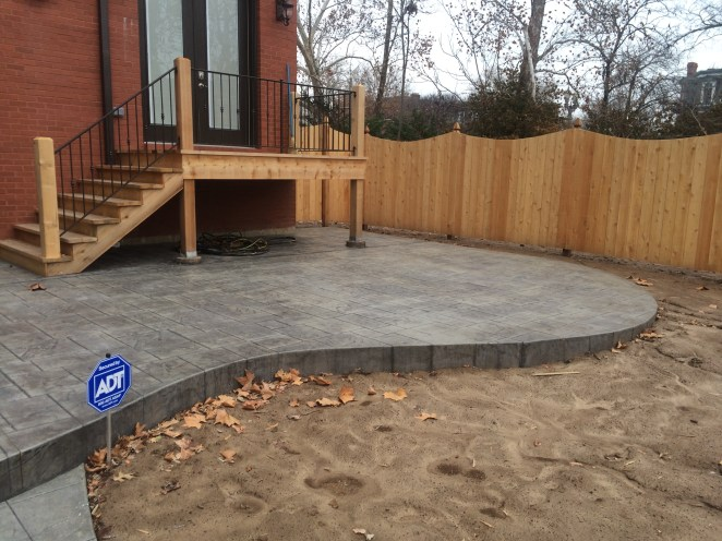 Concrete Patio and Wooden Fence