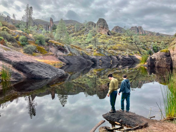 Apollo and Parker take in the view at Bear Gulch Reservoir at Pinnacles national Park.