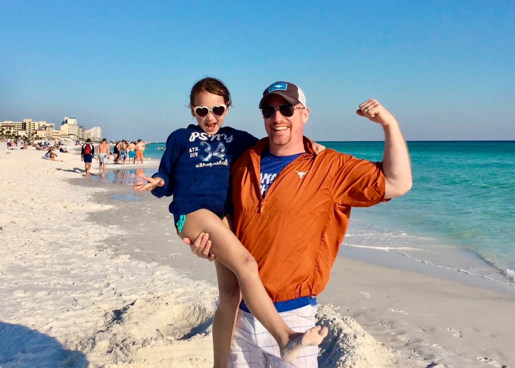 Dad and Halea pose on the beach.  Destin, Florida is the top beach in the contiguous US.  Hoff to See the World loves beaches.