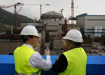 In this Thursday, Oct. 17, 2013, British Chancellor of the Exchequer George Osborne, left, chats with Taishan Nuclear Power Joint Venture Co. Ltd. General Manager Guo Liming as he inspects a nuclear reactor under construction at a nuclear power plant in Taishan, southeastern China's Guangdong province. (AP Photo/Bobby Yip, Pool)