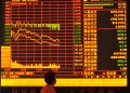 FUYANG, CHINA - JUNE 26£∫(CHINA OUT) An investor observes stock market at a stock exchange hall on June 26, 2015 in Fuyang, Anhui province of China. Chinese stocks dropped sharply on Friday. The benchmark Shanghai Composite Index lost 334.91 points, or 7.40 percent, to close at 4192.87 points. The Shenzhen Component Index shed 1293.66 points, or 8.24 percent, to 14398.78 points. (Photo by ChinaFotoPress/Getty Images)