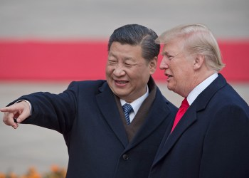 "(FILES) In this file photo taken on November 9, 2017 China's President Xi Jinping (L) and US President Donald Trump attend a welcome ceremony at the Great Hall of the People in Beijing. - President Donald Trump on September 18, 2018 accused China of seeking to influence upcoming US elections by taking aim at his political support base in the countries' escalating trade war. ""China has openly stated that they are actively trying to impact and change our election by attacking our farmers, ranchers and industrial workers because of their loyalty to me,"" Trump tweeted.Trump's comments came a day after he targeted another $200 billion in Chinese imports with tariffs starting next week, drawing an immediate vow of retaliation from Beijing. (Photo by NICOLAS ASFOURI / AFP)NICOLAS ASFOURI/AFP/Getty Images"