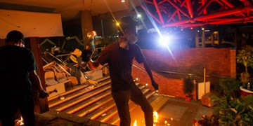 epa08004842 A protesters prepares to throw a petrol bomb inside Polytechnic University of Hong Kong in Hong Kong, China, 18 November 2019. Hong Kong is in its sixth month of mass protests, which were originally triggered by a now withdrawn extradition bill, and have since turned into a wider pro-democracy movement.  EPA/JEROME FAVRE