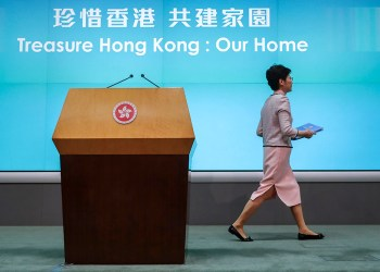Hong Kong Chief Executive Carrie Lam leaves the stage after a press conference at the Legislative Council in Hong Kong Wednesday, Oct. 16, 2019. In chaotic scenes, furious pro-democracy lawmakers twice forced Hong Kong's leader to stop delivering a speech laying out her policy objectives and clamored for her to resign after she walked out of the legislature on Wednesday and then delivered the annual address 75 minutes late via television. (AP Photo/Mark Schiefelbein)