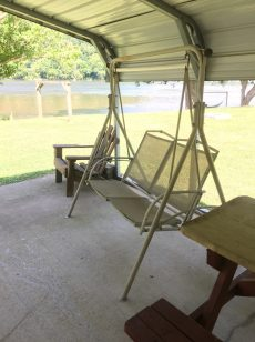 Double porch swing in pavilion