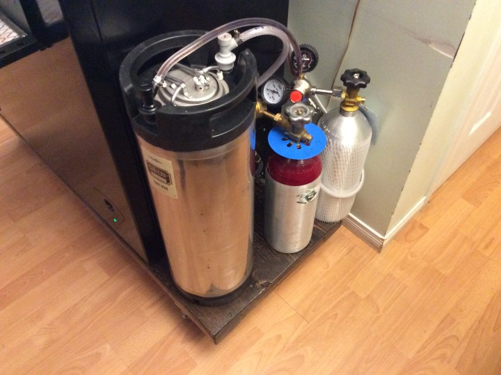 Picture of a kegerator with a Keg containing wine