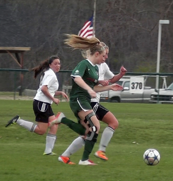 Kaitie contesting a through ball