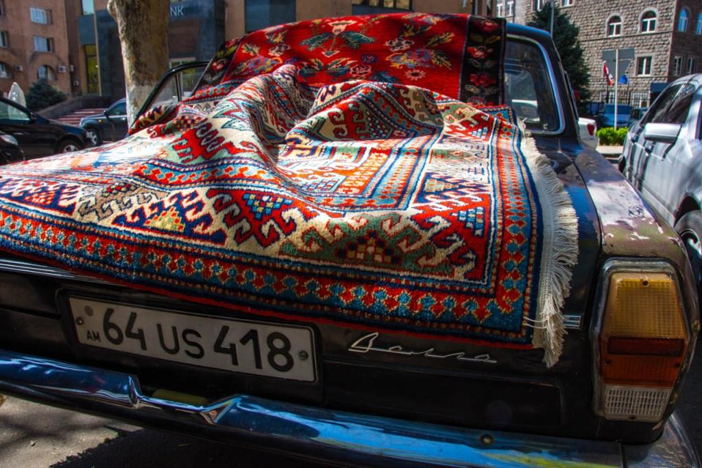 Vintage carpet displayed on a vintage Volga in Yerevan