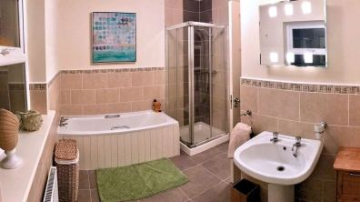 Large bathroom with bath and separate shower