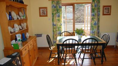 Dining area with patio doors at Skylark Cottage Dunfanaghy