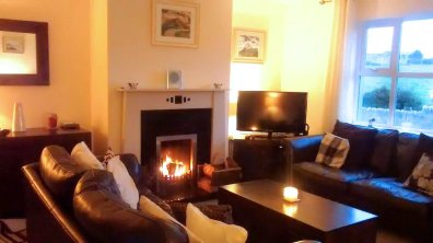 Open fireplace in living area of Lakeview Dunfanaghy