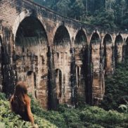 Photo for the blog post about the best places in Sri Lanka. Girl next to Nine Arches Bridge in Sri Lanka