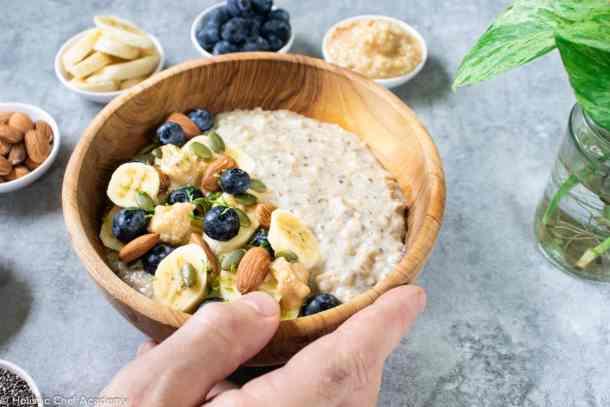 Jamie serving a bowl of quinoa porridge for breakfast