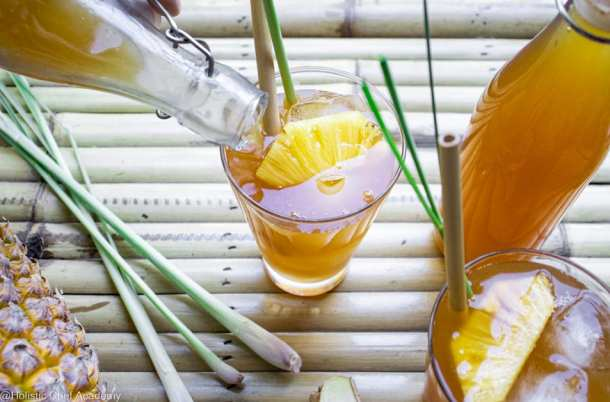 pouring pineapple tepache