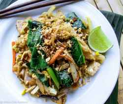 pad see ew noodles with chopsticks and lime