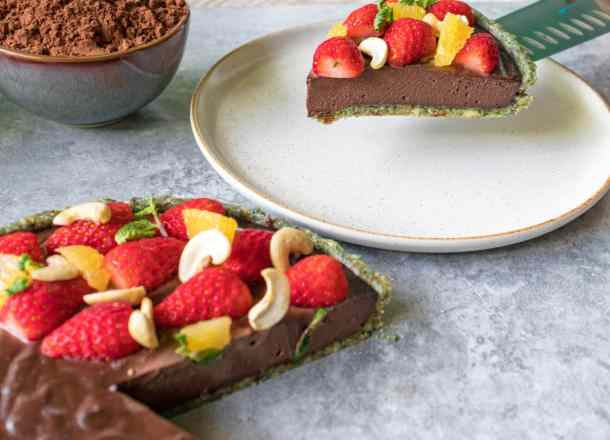 raw chocolate vegan cheesecake slice been put on a plate