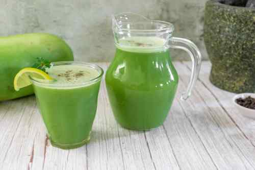 ash-gourd-juice-served-with-lemon-and-a-sprig-of-mint