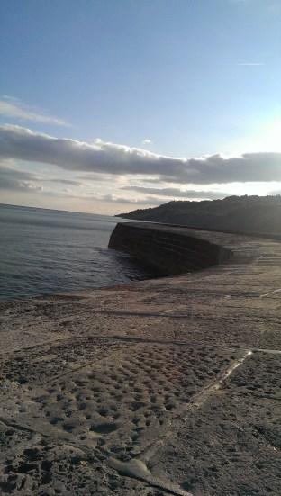 July: walking The Cobb, Lyme Regis