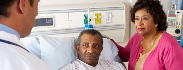 patient-in-hospital-bed-speaking-to-doctor-and-partner-e1452610647550.jpg
