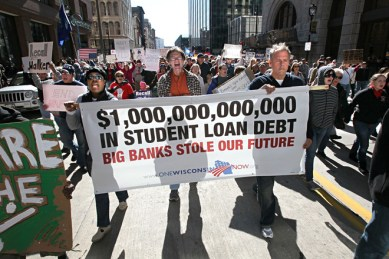October 15, 2011 Photographs from he Occupy Milwaukee protest and march to the JP Morgan Chase Bank and the M&I Bank in Milwaukee. Here protesters march along N. Water Street past the JP Morgan Chase Bank to the M&I Bank building. This group holding a banner protesting the cost of college loans debt. MICHAEL SEARS/MSEARS@JOURNALSENTINEL.COM