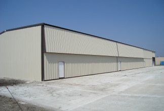 An airport hangar at Algona Municipal Airport in Algona, Iowa, constructed by Holland Contracting in April 2007.