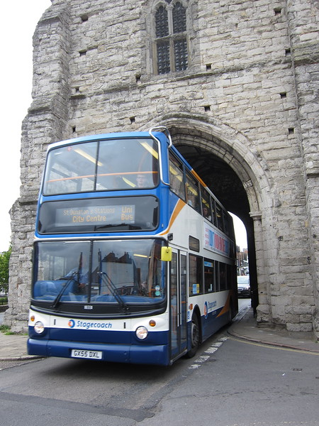 Bus emerging from far side