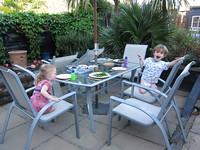 Silly children await dinner