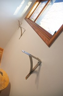 We positioned the three heavy duty brackets, so that the shelf rested about three inches under the window.