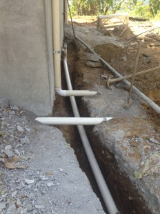the ditch that connects the house to water and power
